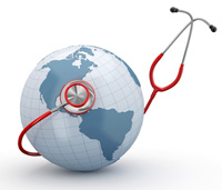 A red stethoscope is wrapped around a miniature globe